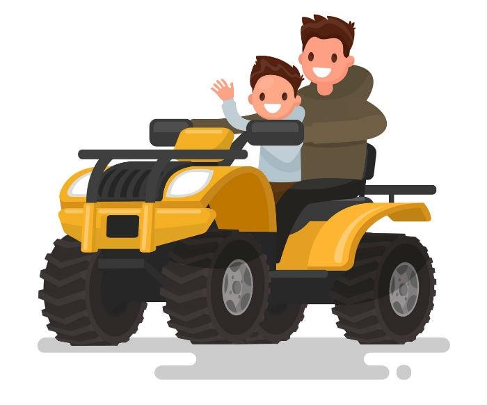 Vater und Sohn fahren Quad
